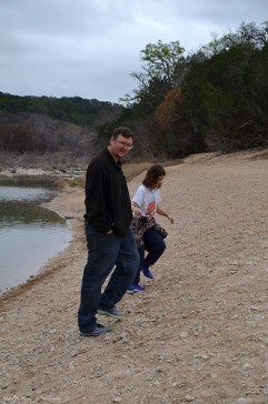 Kevin and Katelynn look for flat stones to skip across the river surface.