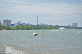 A kayaker is enjoying the lake waves.