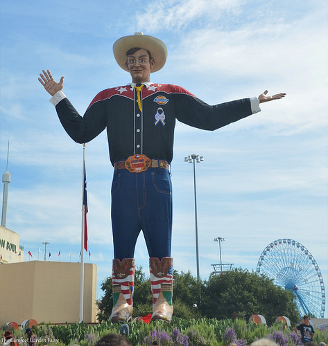 Big Tex with the Texas Star Ferris Wheel in the background