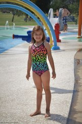 Sara is excited, she can be with her friends at the splash zone.