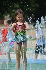 Playing at the splash zone is fun.