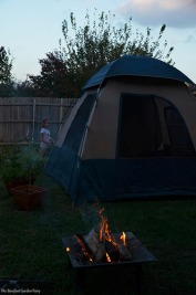 Sara is happy, that the tent is up and the campfire is burning.