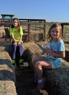 The girls enjoy the hayride.