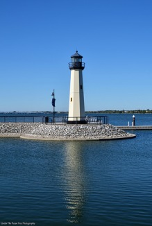The Harbor Lighthouse reflects in the water of Lake Ray Hubbard.