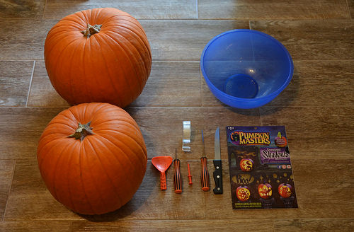 Gathering the tools, bowl, stencils and pumpkins for carving together.