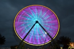 The Ferris wheel in a cloudy November evening background
