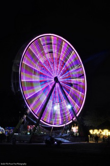 Look closer, and you can see the fireworks behind the Ferris wheel.