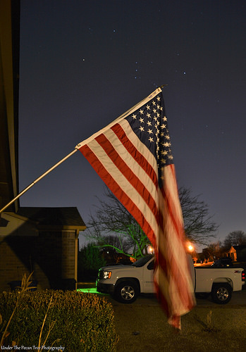 The Star Spangled Banner with the star constellation Orion in the background