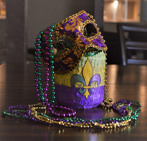The decorated Mardi Gras candle jar might make a good table center piece.
