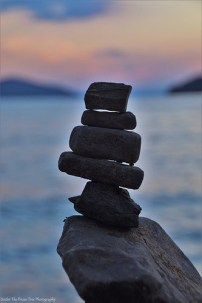 Balancing stones at the lake