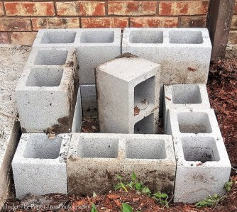 The cinder blocks are put in place.