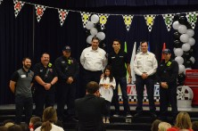 Mirayah Wortman represents her design model with Lionel Racing Director Thomas Deboyace, The Colony Fire Department and NASCAR Driver Aric Almirola.