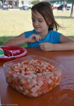 Sara can not wait to dig into the Tomato-Sausage salad for lunch at the Quanah County Safety Rest Area.