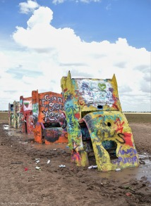 Four of the ten Cadillac, which are half buried in the ground of the Cadillac Ranch by Amarillo.