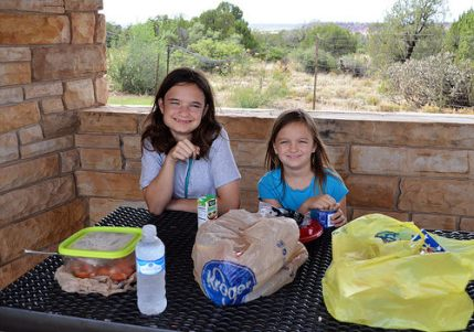 The girls have dinner at the Pajarito Rest Area.