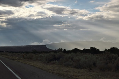 Sun rays and a stunning landscape along Highway 550.