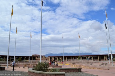 Four Corners Monument: I'm standing in Coloardo, looking towards the Arizona mountains in the background.