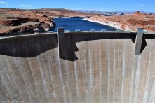 The Glen Canyon Dam with Lake Powell in the background. After the dam was built and ready to hold all this precious water, it took Lake Powell about 17 years to fill up to its full capacity.