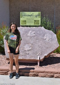 Katelynn in front of some dinosaur foot prints at the Carl Hayden Visitor Center entrance.