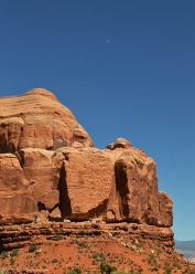 The Waxing Crescent Moon and the red rock