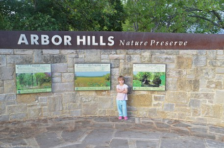 Sara at the entrance of the Arbor Hills Nature Preserve