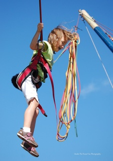 Katelynn loves the jump ropes. She bounced all the way high up in the air.