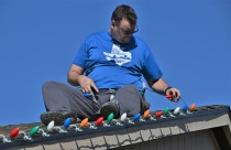 Kevin installs traditionally the Christmas lights on the roof on Black Friday.
