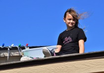 Sara helps day with the extension cords and enjoys the view on top of the roof.