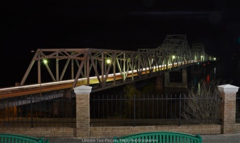 The Vicksburg Bridge at night.