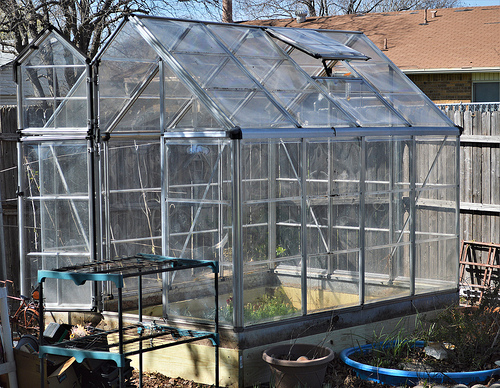 New frame is put together and the greenhouse is back on top of the frames.