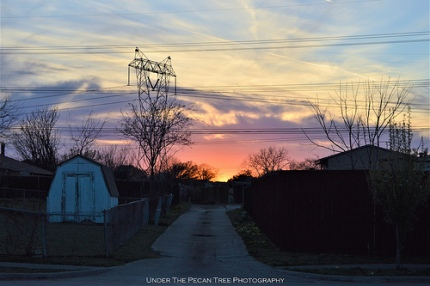 Sunset in a neighborhood back alley