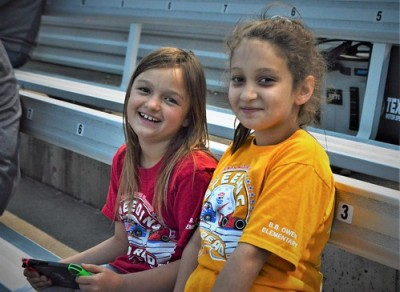 Sara and her friend Mia enjoy the races.