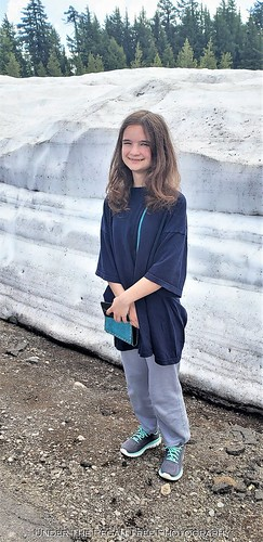 "Katelynn is about 5'2"" (157 cm). That's a lot of snow on the side of the street next to the Crater Lake."