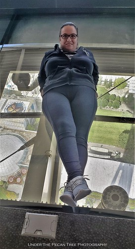 I'm lying on the glass of the rotating lower level more than 500 feet above Seattle.