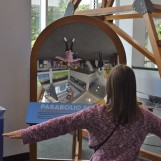 Sara dances in front of the Parabolic Mirror