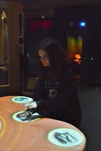 Katelynn plays drums, bongos and other lud drumming instruments on the drum table.