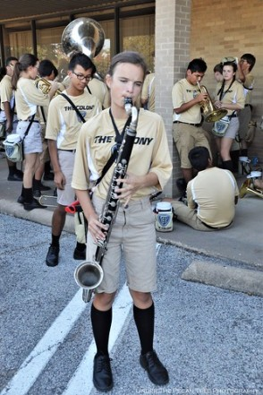 Katelynn keeps herself busy playing the bass clarinet, while she and her band waits for the parade to begin.